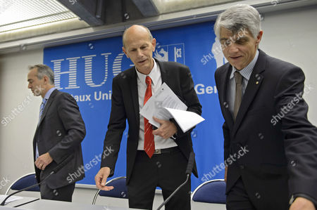Stock Photo of Bertrand Levrat (l-r) General Director Geneva University Hospital Hug Daniel Koch Head of Communicable Diseases Division (ofsp) of the Federal Office of Public Health (foph) and Jacques-andre Romand Cantonal Officer of Health of Geneva Arrive For a Press Conference About a Cuban Doctor who Had Been Diagnosed with Ebola and was Transferred to Geneva For Treatment in the Geneva University Hospital Hug Switzerland 21 November 2014 Switzerland Schweiz Suisse Geneva