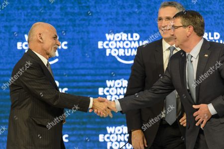 Mohammad Ashraf Ghani (l) President of the Islamic Republic of Afghanistan Shakes Hands with Ashton B Carter (r) Us Secretary of Defense Next to Jens Stoltenberg (c) Secretary-general North Atlantic Treaty Organization (nato) During a Panel Session at the 46th Annual Meeting of the World Economic Forum Wef in Davos Switzerland 22 January 2016 the Overarching Theme of the Meeting Which is Expected to Gather Some 2 500 Leading Politicians Un Executives Heads of Major Corporations Ngo Leaders and Artists at the Annual Four-day Gathering Taking Place From 20 to 23 January is 'Mastering the Fourth Industrial Revolution' Switzerland Schweiz Suisse Davos