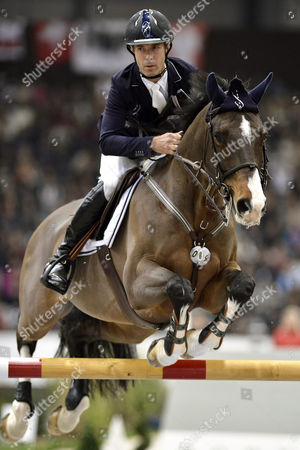 Us Rider Richard Spooner on Horse Cristallo on the Way to Win the Grand Prix Credit Suisse Qualifying Competition For the Fei World Cup Jumping at the 52th Csi-w Show-jumping Tournament in Geneva Switzerland 06 December 2012 Switzerland Schweiz Suisse Geneva