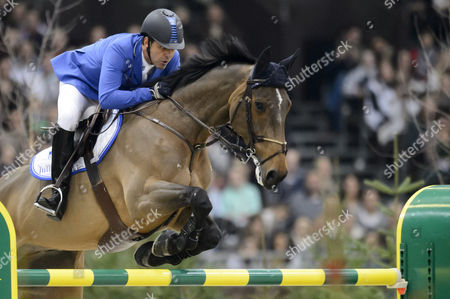 Alvaro De Miranda From Brazil Rides His Horse Ad Rahmannshof's Bogeno to Take the Fifth Place of the Rolex Grand Slam Prix of Show Jumping at the 53rd Chi International Horse Show Jumping Tournament in Geneva Switzerland 15 December 2013 Switzerland Schweiz Suisse Geneva