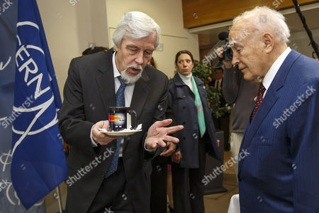 President of Greece Karolos Papoulias (r) and Director General of the European Organization For Nuclear Research (cern) Rolf-dieter Heuer (l) Are Pictured During a Demonstration of the 'Magic Cup' During a Visit to Cern in Meyrin Near Geneva Switzerland 03 May 2014 Switzerland Schweiz Suisse Geneva
