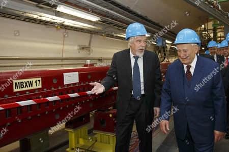 President of Greece Karolos Papoulias (r) and Director General of the European Organization For Nuclear Research (cern) Rolf-dieter Heuer (l) Are Pictured in the Large Hadron Collider (lhd) Tunnel Near the Atlas Experimental Area During a Visit to Cern in Meyrin Near Geneva Switzerland 03 May 2014 Switzerland Schweiz Suisse Geneva