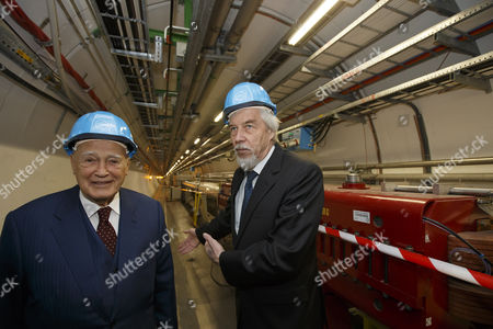 President of Greece Karolos Papoulias (l) and Director General of the European Organization For Nuclear Research (cern) Rolf-dieter Heuer (r) Are Pictured in the Large Hadron Collider (lhd) Tunnel Near the Atlas Experimental Area During a Visit to Cern in Meyrin Near Geneva Switzerland 03 May 2014 Switzerland Schweiz Suisse Geneva