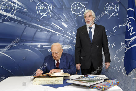 President of Greece Karolos Papoulias (l) Signs the Guestbook Next to Director General of the European Organization For Nuclear Research (cern) Rolf-dieter Heuer (r) During a Visit to Cern in Meyrin Near Geneva Switzerland 03 May 2014 Switzerland Schweiz Suisse Geneva