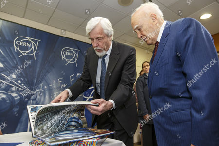 President of Greece Karolos Papoulias (r) Looks at a Book with Director General of the European Organization For Nuclear Research (cern) Rolf-dieter Heuer (l) During a Visit to Cern in Meyrin Near Geneva Switzerland 03 May 2014 Switzerland Schweiz Suisse Geneva