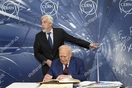 President of Greece Karolos Papoulias (front) Signs the Guestbook Next to Director General of the European Organization For Nuclear Research (cern) Rolf-dieter Heuer During a Visit to Cern in Meyrin Near Geneva Switzerland 03 May 2014 Switzerland Schweiz Suisse Geneva