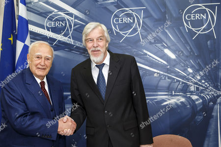 President of Greece Karolos Papoulias (l) Shakes Hands with Director General of the European Organization For Nuclear Research (cern) Rolf-dieter Heuer (r) During a Visit to Cern in Meyrin Near Geneva Switzerland 03 May 2014 Switzerland Schweiz Suisse Geneva