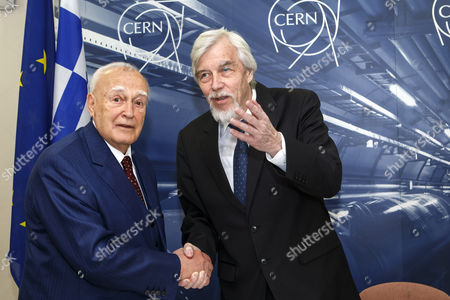 President of Greece Karolos Papoulias (l) Shakes Hand with Director General of the European Organization For Nuclear Research (cern) Rolf-dieter Heuer (r) During a Visit to Cern in Meyrin Near Geneva Switzerland 03 May 2014 Switzerland Schweiz Suisse Geneva