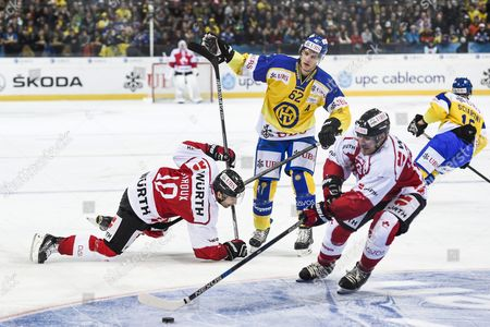 Team Canada's Alexandre Giroux Left and Matthew Lombardi Fight For the Puck with Davos' Felicien Du Bois Center During the Game Between Switzerland's Hc Lugano and Finland's Jokerit Helsinki at the 89th Spengler Cup Ice Hockey Tournament in Davos Switzerland 28 December 2015 Switzerland Schweiz Suisse Davos