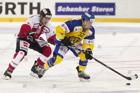 Team Canada's Matthew Lombardi (l) Fight For the Puck with Davos' Sin Schlaepfer During the Game Between Team Canada and Switzerland's Hc Davos at the 89th Spengler Cup Ice Hockey Tournament in Davos Switzerland 28 December 2015 Switzerland Schweiz Suisse Davos