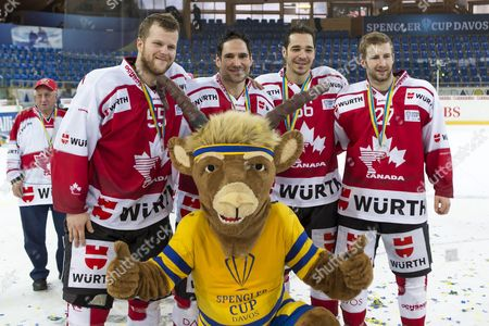 Team Canada's (l-r) Daniel Vukovic Matthew Lombardi Matt D'agostini and Tom Pyatt Celebrate with Mascot Hitsch After Winning the Final Match Between Team Canada and Switzerland's Hc Lugano at the 89th Spengler Cup Ice Hockey Tournament in Davos Switzerland 31 December 2015 Switzerland Schweiz Suisse Davos