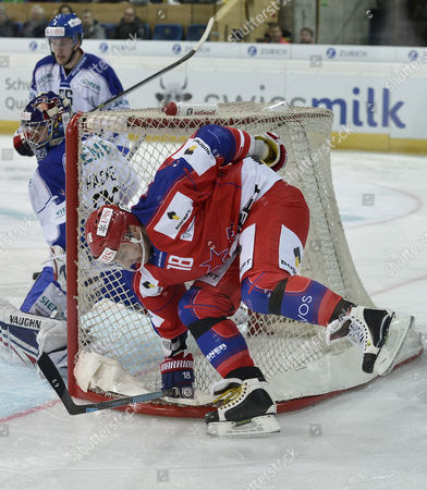 Moscow's Sergei Fedorov (r) Vies For the Puck with Rochester's Goalkeeper Matthew Hackett During the Game Between Cska Moscow and Rochester Americans at the 87th Spengler Cup Ice Hockey Tournament in Davos Switzerland 27 December 2013 Switzerland Schweiz Suisse Davos
