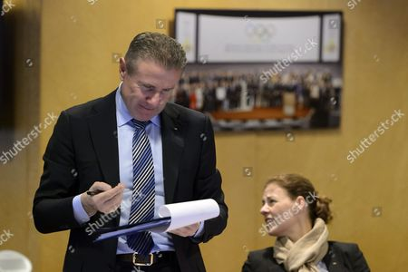 Ukrainian Sergei Bubka (l) Member of the International Olympic Committee (ioc) Signs a Document Next to Ioc Member Claudia Bokel (r) From Germany During the Opening of an Executive Board Meeting of the International Olympic Committee at the Ioc Headquarters in Lausanne Switzerland 08 December 2015 Switzerland Schweiz Suisse Lausanne