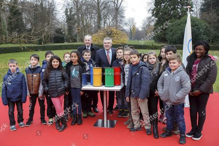 Jacques Rogge Left Former President of the International Olympic Committee (ioc) and German Thomas Bach Right President of the International Olympic Committee (ioc) Pose with of Children After the Laying of the Foundation Stone Ceremony For Ioc's New Building in Lausanne Switzerland 08 December 2015 Switzerland Schweiz Suisse Lausanne