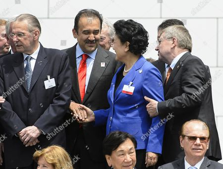 Liu Yandong (2-r) Vice Premier of the State Council of China Shakes Hands with Karim Massimov (2-l) Kazakhstan's Prime Minister and Chairman of the Almaty 2022 Bid Committee Next to International Olympic Committee (ioc) President Thomas Bach (r) of Germany and Former Ioc President Jacques Rogge (l) After the Presentation of the 2022 Winter Olympics Bid Delegations During the 2022 Candidate City Briefing For Ioc Members at the Olympic Museum in Lausanne Switzerland 09 June 2015 Switzerland Schweiz Suisse Lausanne
