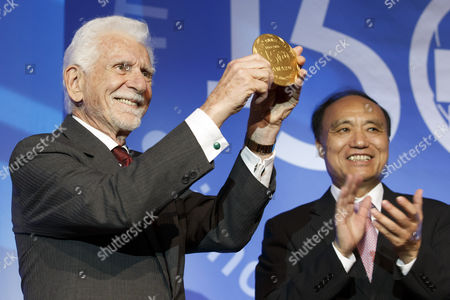 Martin Cooper (l) of the Usa a Pioneer in the Wireless Communications Industry Receives the Itu 150 Award by Zhao Houlin (r) From China Secretary-general of the International Telecommunication Union (itu) During the Opening Ceremony of Itu's 150th Anniversary Celebration in Geneva Switzerland 17 May 2015 Switzerland Schweiz Suisse Geneva