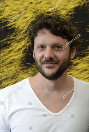 Stock Image of Romanian Actor Bogdan Dumitrache Poses During a Photocall For the Movie 'Cand Se Lasa Seara Peste Bucuresti Sau Metabolism' at the 66th Locarno International Film Festival in Locarno Switzerland 09 August 2013 the Festival Runs From 07 to 17 August Switzerland Schweiz Suisse Locarno