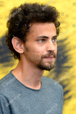 Stock Image of Actor Tawfeek Barhom Poses During a Photocall For the Movie 'Dancing Arabs' at the 67th Locarno International Film Festival in Locarno Switzerland 07 August 2014 the Festival Runs From 06 to 16 August Switzerland Schweiz Suisse Locarno