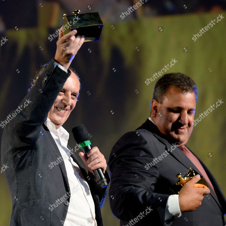 Stock Photo of Italian Film Director Dario Argento (l) and Actor Guido Lombardo (r) Pose on Stage at the Piazza Grande with Their Awards 'Piccolo Pardo' During the 67th Locarno International Film Festival in Locarno Switzerland 08 August 2014 About 8 000 People Are Expected to Attend Every Night Open-air Screenings on Locarnos Famous Square the Piazza Grande the Festival Takes Place From 06 to 16 August Switzerland Schweiz Suisse Locarno
