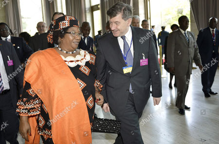 Malawi's President Joyce Banda (l) is Welcomed by British Guy Ryder (r) General Director of International Labour Organisation (ilo) During the 102nd Ilo Conference at the European Headquarters of the United Nations in Geneva Switzerland 12 June 2013 Switzerland Schweiz Suisse Geneva Geneve Ginevra Genf