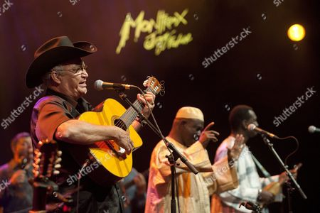The Group 'Afrocubism' with Cuban Singer Eliades Ochoa Left and Malian Singers Kasse Mady Diabate Centre and Toumani Diabate Right Plays on the Stravinski Hall Stage During the 46th Montreux Jazz Festival in Montreux Switzerland 30 June 2012 Switzerland Schweiz Suisse Montreux