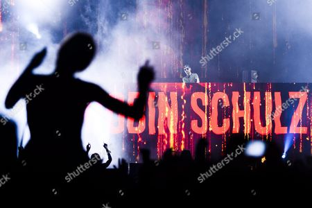 A Picture Made Available on 20 August 2016 Shows the Audience Enjoying During the Performance of the German Dj Robin Schulz (back) at the Music Open Air Festival in Gampel Switzerland 19 August 2016 the Annual Festival Runs From 18 to 21 August Switzerland Schweiz Suisse Gampel
