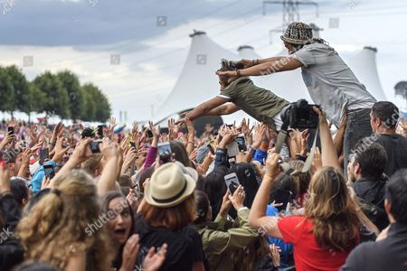 Stock Image of Jeremy Frerot (2-r) and Florian Delavega (r) of French Musical Duo Frero Delavega Dive Into the Crowd As They Perform on the Main Stage During the 41st Paleo Festival Nyon in Nyon Switzerland 23 July 2016 the Open-air Music Festival the Largest in the Western Part of Switzerland Runs From 19 to 24 July Switzerland Schweiz Suisse Nyon