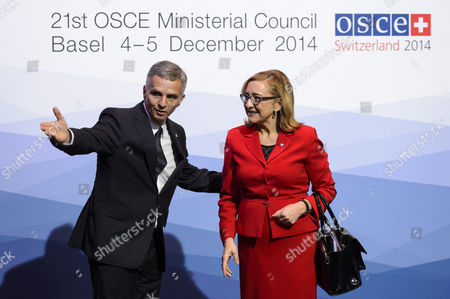 Switzerland's Federal President and Osce Chairperson-in-office Didier Burkhalter (l) Welcomes New Georgian Foreign Minister Tamar Beruchashvili (r) Before the Opening Session of the 21st Organization For Security and Co-operation in Europe (osce) Ministerial Council at the Basel Exhibition Center in Basel Switzerland 04 December 2014 Switzerland Schweiz Suisse Basel
