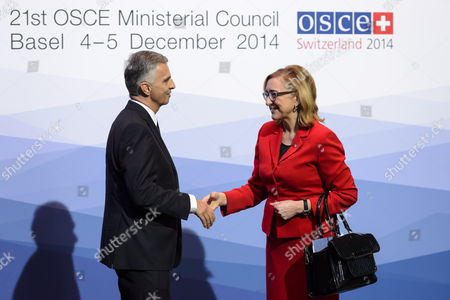 Switzerland's Federal President and Osce Chairperson-in-office Didier Burkhalter (l) and New Georgian Foreign Minister Tamar Beruchashvili (r) Shake Hands Before the Opening Session of the 21st Organization For Security and Co-operation in Europe (osce) Ministerial Council at the Basel Exhibition Center in Basel Switzerland 04 December 2014 Switzerland Schweiz Suisse Basel