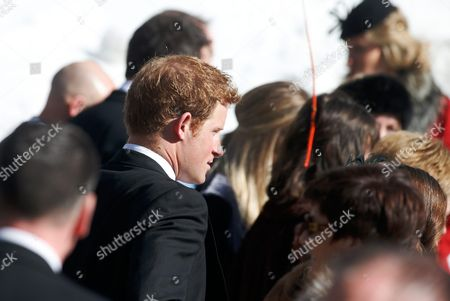 British Prince Harry and Guests Enter the Evangelical Church in Arosa Switzerland 02 March 2013 Prince William His Wife and Prince Harry Attend a Wedding of Their Friends Swiss-british Dressage Rider Laura Bechtolsheimer and Poloplayer Mark Tomlinson Switzerland Schweiz Suisse Arosa