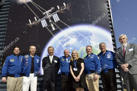 From L-r Nasa Astronaut Gregory Errol Chamitoff Nasa Astronaut Andrew J Feustel Nobel Laureate and Ams Spokesperson Samuel C C Ting Nasa Astronaut and Commander of Mission Sts-134 Mark Kelly Wife of Ams Spokesperson Dr Susan Carol Marks Nasa Astronaut Edward Michael Fincke Nasa Astronaut Gregory H Johnson and Director General of Cern Rolf-dieter Heuer Pose in Front of the Alpha Magnetic Spectrometer (ams) Payload Operations and Command Center (pocc) at the European Organization For Nuclear Research (cern) in Meyrin Near Geneva Switzerland 25 July 2012 the Astronaut's Visit to the Cern Marks the 14th Month Anniversary of the Installation of the Cosmic Ray Detector on the International Space Station (iss) by the Astronauts During the Last Mission of the Space Shuttle Endeavour Code-named Sts-134 when They Flew the Alpha Magnetic Spectrometer For the European Organization For Nuclear Research to the Iss Switzerland Schweiz Suisse Geneva