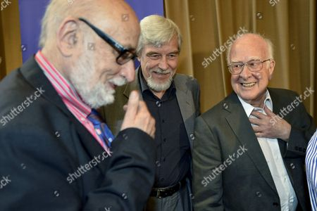 Belgium Physicist Francois Englert (l) Rolf Heuer (c) Director General of Cern (european Organization For Nuclear Research) and British Physicist Peter Higgs (r) Leave After the Answering Journalists Question About the Scientific Seminar to Deliver the Latest Update in the Search For the Higgs Boson at the European Organization For Nuclear Research (cern) in Meyrin Near Geneva Switzerland 04 July 2012 Scientists Report 04 July 2012 They Have Discovered a New Type of Particle Consistent with the Long-sought Higgs Boson Which Would Explain why There is Mass in the Universe the Cern Laboratory Announced in Geneva However the Experiment's Spokesperson Joe Icandela Stressed That the Results Were Preliminary 'The Implications Are Very Significant and It is Precisely For This Reason That We Must Be Extremely Diligent in All of Our Studies and Cross-checks ' British Scientist Peter Higgs and Others Developed a Theory Explaining why Matter Exists by Introducing the Higgs Boson As a Key Part of the Mechanism That Allows Particles to Gain Mass Switzerland Schweiz Suisse Meyrin
