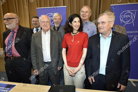 Belgium Phycisit Francois Englert (l) British Physicist Peter Higgs (3rd L) Poses with Fabiola Gianotti Atlas Experiment Spokesperson (4th R) Next to Cern Director General Rolf Heuer (4th L) and Others Scientists After a Answers Journalist's Question About the Scientific Seminar to Deliver the Latest Update in the Search For the Higgs Boson at the European Organization For Nuclear Research (cern) in Meyrin Near Geneva Switzerland Wednesday July 4 2012 (keystone/martial Trezzini) Switzerland Schweiz Suisse Geneva Geneve Ginevra Genf