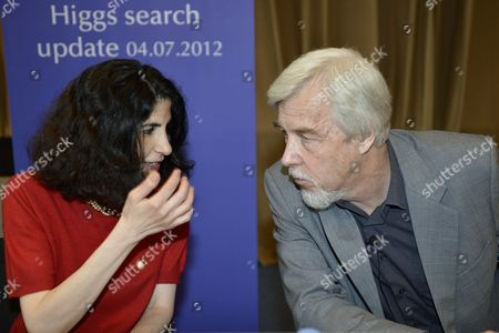 Rolf Heuer (r) Director General of Cern (european Organization For Nuclear Research) and Fabiola Gianotti (l) Atlas Experiment Spokesperson Answers Journalist's Question About the Scientific Seminar to Deliver the Latest Update in the Search For the Higgs Boson at the European Organization For Nuclear Research (cern) in Meyrin Near Geneva Switzerland 04 July 2012 Switzerland Schweiz Suisse Geneva