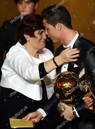 Real Madrid's Portuguese Striker Cristiano Ronaldo (r) is Embraced by His Mother Maria Dolores Dos Santos Aveiro (l) After Receiving the Fifa Men's World Player of the Year 2013 Award During the Fifa Ballon D'or 2013 Gala at the Kongresshaus in Zurich Switzerland 13 January 2014 Switzerland Schweiz Suisse Zurich
