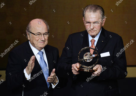 Former Ioc President Jacques Rogge (r) Receives the Presidential Award From Fifa President Sepp Blatter (l) During the Fifa Ballon D'or 2013 Awarding Ceremony at the Kongresshaus in Zurich Switzerland 13 January 2014 Switzerland Schweiz Suisse Zurich