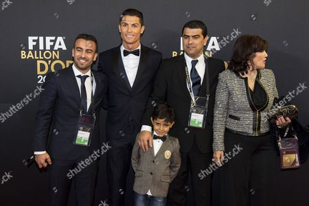 Portuguese Striker Cristiano Ronaldo (2-l) Arrives on the Red Carpet with His Son Cristiano Jr (c) His Mother Maria Dolores Dos Santos Aveiro (r) and His Brother Hugo (l) Prior to the Fifa Ballon D'or 2014 Gala Held at the Kongresshaus in Zurich Switzerland 12 January 2015 Cristiano Ronaldo Has Been Named Fifa Ballon D'or World Player of the Year 2014 Switzerland Schweiz Suisse Zurich