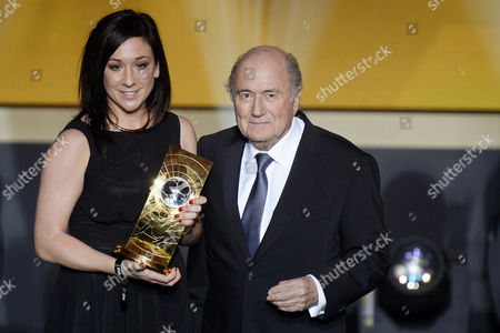German Soccer Player Nadine Kessler (l) Poses For Photographers with Fifa President Joseph Blatter (r) After Receiving the Fifa Women's World Player of the Year 2014 Award at the Fifa Ballon D'or 2014 Gala Held at the Kongresshaus in Zurich Switzerland 12 January 2015 Switzerland Schweiz Suisse Zurich