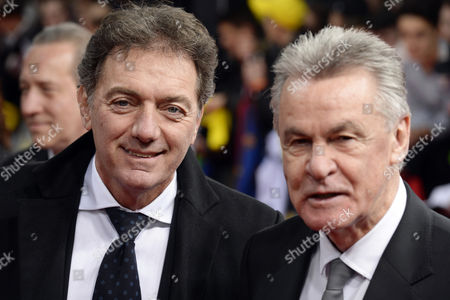 Stock Image of Former Coach of the Swiss National Soccer Team German Ottmar Hitzfeld (r) and His Assistent Michel Pont (l) Arrive on the Red Carpet Prior to the Fifa Ballon D'or 2014 Gala Held at the Kongresshaus in Zurich Switzerland 12 January 2015 Switzerland Schweiz Suisse Zurich