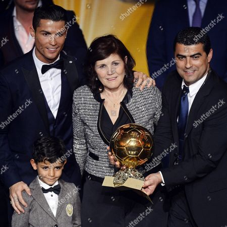 Portuguese Striker Cristiano Ronaldo (l) Poses For Photographers with His Son Cristiano Jr His Mother Maria Dolores Dos Santos Aveiro (c) and His Brother Hugo (r) After Receiving the Fifa Ballon D'or World Player of the Year 2014 Award During the Fifa Ballon D'or 2014 Gala Held at the Kongresshaus in Zurich Switzerland 12 January 2015 Switzerland Schweiz Suisse Zurich