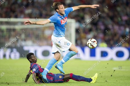 Stock Photo of Fc Barcelona's Edgar Ie (l) in Action Against Napoli's Miguel Perez Cuesta During a Friendly Soccer Match Between Fc Barcelona and Ssc Napoli at the Stade De Geneve in Geneva Switzerland 06 August 2014 Switzerland Schweiz Suisse Geneva