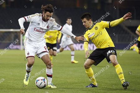 Milan's Cristian Zaccardo (l) Fights For the Ball with Bern's Thomas Fekete (r) During a Friendly Soccer Match Between Switzerland's Young Boys Bern and Italy's Ac Milan at the Stade De Suisse Stadium in Bern Switzerland 16 November 2013 Switzerland Schweiz Suisse Bern
