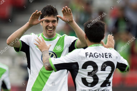 Stock Photo of Wolfsburg's Felipe Lopes (l) Celebrates After Scoring a Goal with Teammate Conserva Lemos Fagner (r) During the Valais Cup Tournament Soccer Match Between French As Saint-etienne and German Vfl Wolfsburg at the Stade De Tourbillon Stadium in Sion Switzerland 09 July 2013 Switzerland Schweiz Suisse Sion