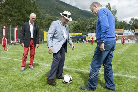 (l-r) Former German Soccer Player Franz Beckenbauer Fifa President Swiss Joseph Sepp Blatter and Former Head Coach of Swiss Team German Ottmar Hitzfeld Kick Off the Junior Final During the Sepp Blatter Soccer Tournament in Ulrichen Switzerland 09 August 2014 when Blatter was Elected Fifa President in 1998 Blatter's Hometown Ulrichen Awarded Him with the Honorary Citizen of Ulrichen Title and to Commemorate the Occasion a Football Tournament Bearing His Name was Created Switzerland Schweiz Suisse Ulrichen