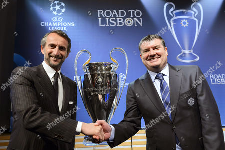 Chelsea's Chief Executive Ron Gourlay (r) Shakes Hands with Paris Saint Germain's Director General Jean-claude Blanc (l) in Front of the Champions League Trophy After the Draw of the Quarter Finals of Uefa Champions League 2013/14 at the Uefa Headquarters in Nyon Switzerland 21 March 2014 Switzerland Schweiz Suisse Nyon