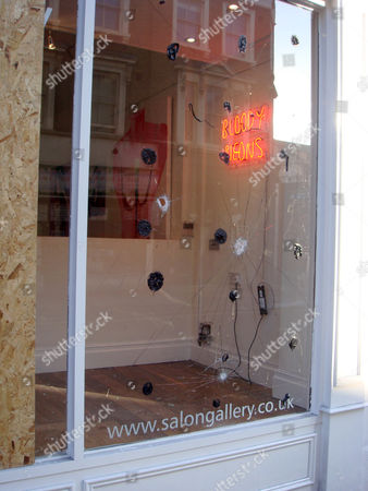 Smashed windows at the Salon Gallery