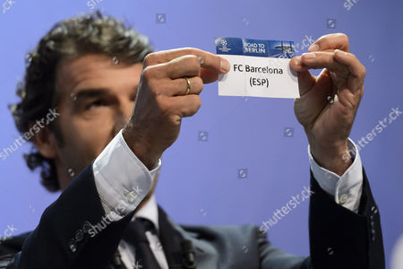 Former German Soccer Player Karl-heinz Riedle Ambassador For the Uefa Champions League Final in Berlin Shows the Lot of Fc Barcelona During the Draw of the Semi-finals of Uefa Champions League 2014/15 at the Uefa Headquarters in Nyon Switzerland 24 April 2015 Switzerland Schweiz Suisse Nyon