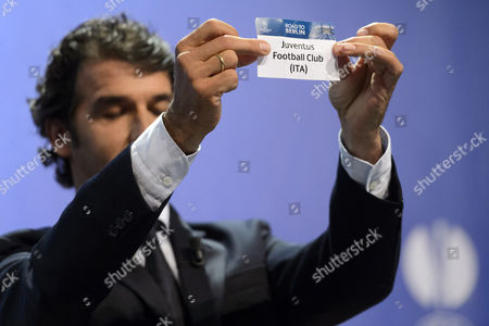 Former German Soccer Player Karl-heinz Riedle Ambassador For the Uefa Champions League Final in Berlin Shows the Lot of Juventus Fc During the Draw of the Semi-finals of Uefa Champions League 2014/15 at the Uefa Headquarters in Nyon Switzerland 24 April 2015 Switzerland Schweiz Suisse Nyon