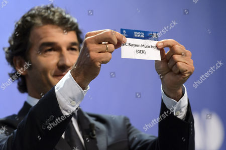 Former German Soccer Player Karl-heinz Riedle Ambassador For the Uefa Champions League Final in Berlin Shows the Lot of Bayern Munich During the Draw of the Semi-finals of Uefa Champions League 2014/15 at the Uefa Headquarters in Nyon Switzerland 24 April 2015 Switzerland Schweiz Suisse Nyon