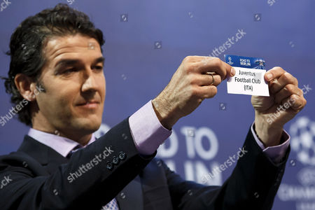 Former German Soccer Player Karl-heinz Riedle Ambassador For the Uefa Champions League Final in Berlin Shows the Ticket of Juventus Fc During the Draw of the Uefa Champions League 2014-15 Quarter Final Matches at the Uefa Headquarters in Nyon Switzerland 20 March 2015 Switzerland Schweiz Suisse Nyon